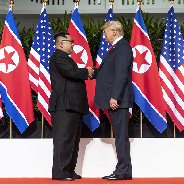 Kim_and_Trump_shaking_hands_at_the_red_carpet_during_the_DPRK–USA_Singapore_Summit